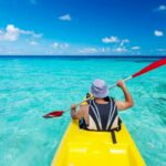 kayaking in clear blue water