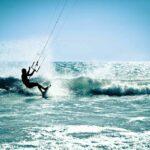 kitesurfer riding wave