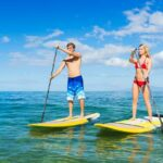 paddleboard couple on the water