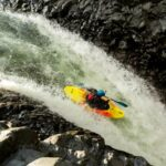 whitewater kayak in waterfall copy
