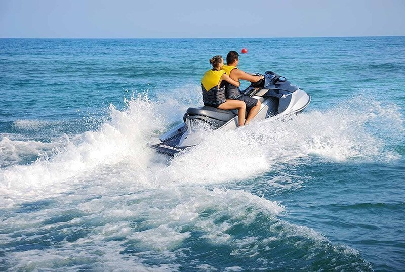 jetski couple in blue water gallery extrevity